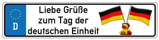 Schild mit Grüßen zur deutschen Einheit